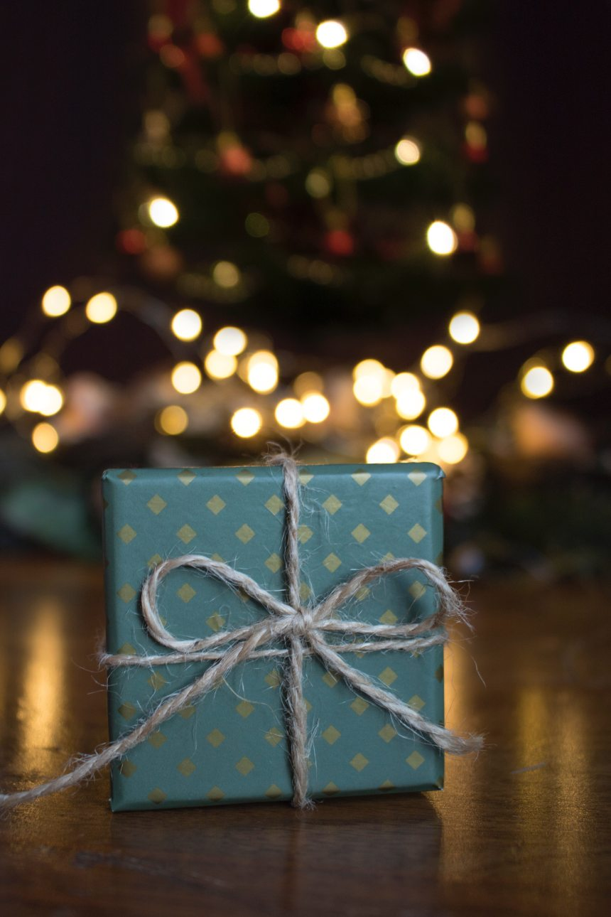close-up-photo-of-green-gift-box-on-brown-wooden-surface-1681147
